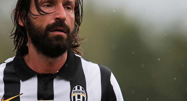 In this file photo taken on August 20, 2014 Juventus A' Italian midfielder Andrea Pirlo looks on during a friendly football match between Juventus A and Juventus B in Villar Perosa near Turin. Andrea Pirlo was named as new Juventus coach - club on August 8, 2020. Marco BERTORELLO / AFP