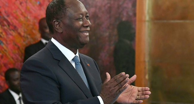A picture taken on August 5, 2019 shows Ivory Coast President Alassane Ouattara applauding during a ceremony at the presidential palace in Abidjan. ISSOUF SANOGO / AFP