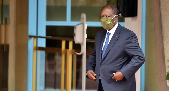 Ivory Coast President Alassane Ouattara wearing a protective mask attends a ceremony to mark the 60th anniversary of the country Independance from France on August 7, 2020 at the presidential palace in Abidjan. SIA KAMBOU / AFP
