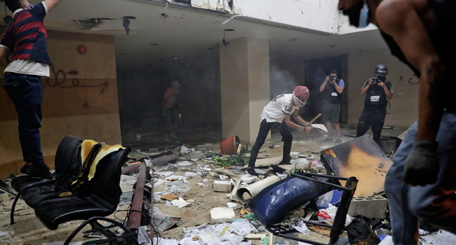 Lebanese protesters destroy the interior of the headquarters of the Lebanese association of banks in downtown Beirut on August 8, 2020, following a demonstration against a political leadership they blame for a monster explosion that killed more than 150 people and disfigured the capital Beirut. ANWAR AMRO / AFP