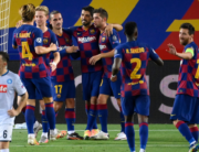 Barcelona's Uruguayan forward Luis Suarez (rear R) celebrates with teammates after scoring penalty kick during the UEFA Champions League round of 16 second leg football match between FC Barcelona and Napoli at the Camp Nou stadium in Barcelona on August 8, 2020. LLUIS GENE / AFP