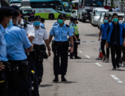 Police cordon off the street outside the Next Media publishing offices as authorities conduct a search of the premises after the company's founder Jimmy Lai was arrested under the new national security law in Hong kong on August 10, 2020. ISAAC LAWRENCE / AFP