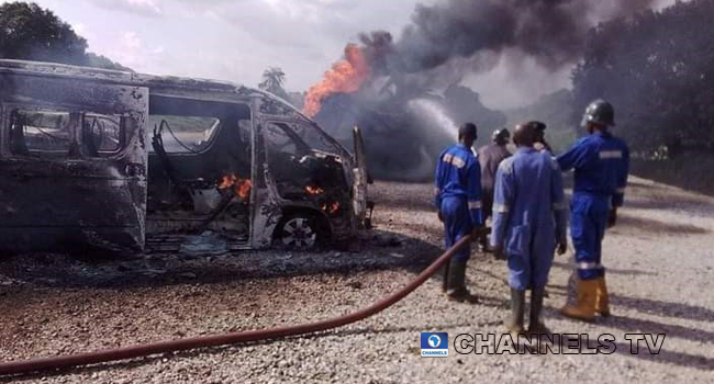Firefighters battle the ensuing flames after two tankers collided in Niger State.