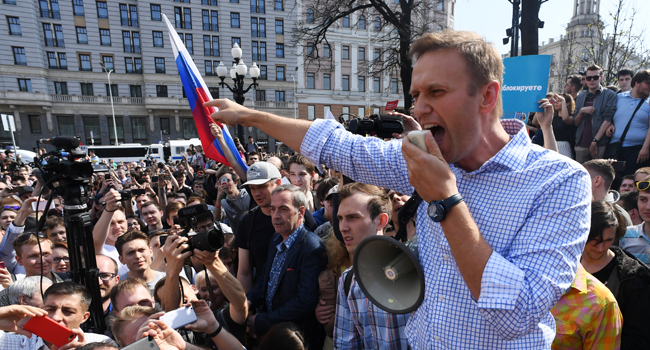 In this file photo taken on May 05, 2018 Russian opposition leader Alexei Navalny addresses supporters during an unauthorized anti-Putin rally in Moscow, two days ahead of Vladimir Putin's inauguration for a fourth Kremlin term. Kirill KUDRYAVTSEV / AFP