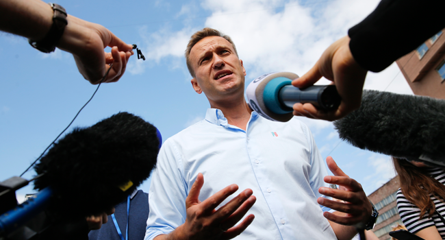 In this file photo taken on July 20, 2019 Russian opposition leader Alexei Navalny speaks with journalists during a rally to support opposition and independent candidates after authorities refused to register them for September elections to the Moscow City Duma, Moscow. Maxim ZMEYEV / AFP