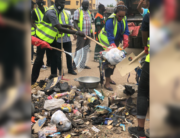A photo showing Lagos state officials cleaning up the streets.