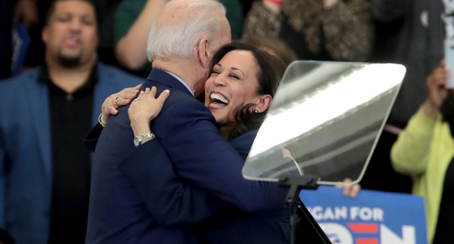 In this file photo taken on March 09, 2020, US Senator Kamala Harris (L) hugs Democratic presidential candidate Joe Biden after introducing him at a campaign rally at Renaissance High School in Detroit, Michigan. SCOTT OLSON / GETTY IMAGES NORTH AMERICA / AFP