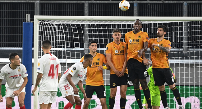 The wolves wall jumps for a free kick during the UEFA Europa League quarter-final football match Wolverhampton Wanderers v Sevilla at the MSV Arena on August 11, 2020 in Duisburg, western Germany. Ina Fassbender / POOL / AFP