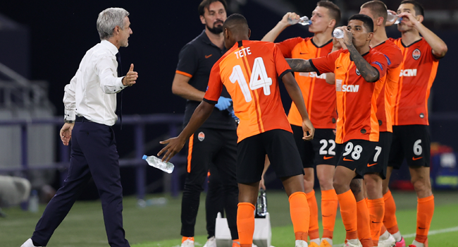 Shakhtar Donetsk's Portuguese coach Luis Castro (L) congratulates his players during the UEFA Europa League quarter-final football match Shakhtar Donetsk v FC Basel at the Arena Aufschalke on August 11, 2020 in Gelsenkirchen, western Germany. WOLFGANG RATTAY / POOL / AFP