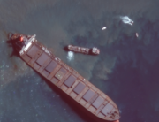 This August 12, 2020, handout satellite image obtained courtesy of Maxar Technologies shows the MV Wahashio shipwreck off the southeast coast of Mauritius. Handout / Satellite image ©2020 Maxar Technologies / AFP