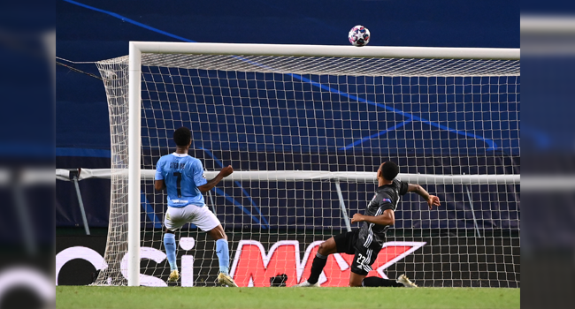 Manchester City's English midfielder Raheem Sterling (L) misses a goal opportunity during the UEFA Champions League quarter-final football match between Manchester City and Lyon at the Jose Alvalade stadium in Lisbon on August 15, 2020. FRANCK FIFE / POOL / AFP