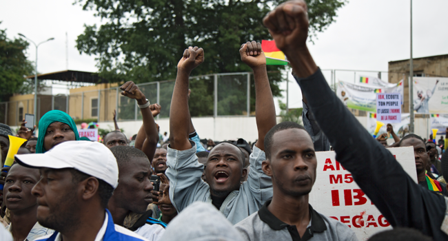 A man cheers during a protest organised by M5-RFP, who are calling for Malian President Ibrahim Boubacar Keita to resign, in Bamako on August 11, 2020.  ANNIE RISEMBERG / AFP