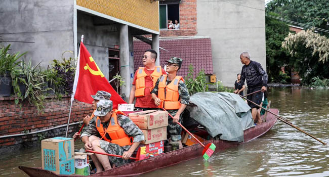 China Floods Force Hundreds Of Thousands Out Of Homes