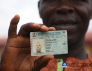 A man displays his voter's card on September 19, 2020. Photo credit: Sodiq Adelakun/Channels Television.