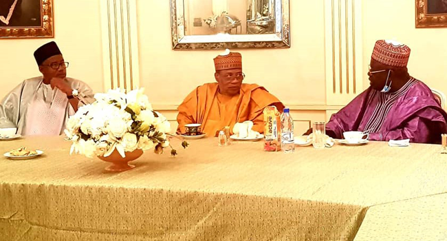 (L-R) Bauchi State Governor, Bala Mohammed, former Head of State, Ibrahim Babangida and former Niger State Governor, Aliyu Babangida discuss during a PDP reconciliation committee visit to former Head of State Babangida in Minna on September 26, 2020.