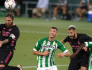 Real Madrid's Spanish defender Sergio Ramos (L) heads the ball next to Real Betis' Argentinian midfielder Guido Rodriguez, French forward Karim Benzema and Portuguese midfielder William Carvalho during the Spanish league football match Real Betis against Real Madrid CF at the Benito Villamarin stadium in Seville on September 26, 2020. JORGE GUERRERO / AFP