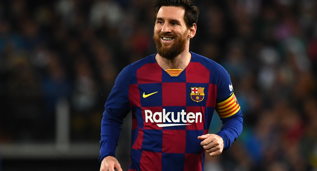 In this file photo taken on March 01, 2020, Barcelona's Argentine forward Lionel Messi smiles during the Spanish League football match between Real Madrid and Barcelona at the Santiago Bernabeu stadium in Madrid. GABRIEL BOUYS / AFP
