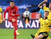 Portugal's forward Cristiano Ronaldo (L) shoots past Sweden's defender Filip Helander (C) and Sweden's defender Pontus Jansson during the UEFA Nations League football match between Sweden and Portugal on September 8, 2020 in Solna, Sweden. Jonathan NACKSTRAND / AFP