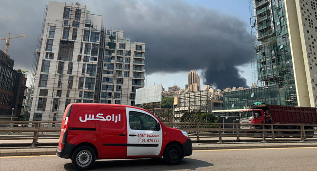 A picture taken from Dbayeh, north of Beirut, shows smoke from a huge fire raging at the port in the Lebanese capital on September 10, 2020. Thick black columns of smoke rose into the sky, as the army said it had engulfed a warehouse storing engine oil and vehicle tyres.  Joseph EID / AFP