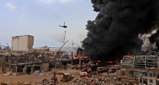 Lebanese firefighters try to put out a fire that broke out at Beirut's port area, on September 10, 2020. Thick black columns of smoke rose into the sky, as the army said it had engulfed a warehouse storing engine oil and vehicle tyres.  ANWAR AMRO / AFP