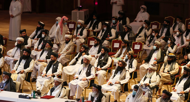 Members of the Taliban delegation attend the opening session of the peace talks between the Afghan government and the Taliban in the Qatari capital Doha on September 12, 2020. KARIM JAAFAR / AFP