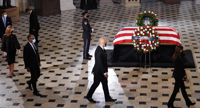 : Mourners surround the flag-draped casket of the late Associate Justice Ruth Bader Ginsburg as she lies in state inside the Statuary Hall of the U.S. Capitol September 25, 2020 in Washington, DC. Olivier Douliery-Pool/Getty Images/AFP