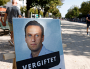 "A poster with a picture of Russian opposition leader Alexei Navalny with the headline ""poisoned"" is seen outside the Russian embassy on Unter den Linden in Berlin during an anti-government protest on September 23, 2020. Odd ANDERSEN / AFP"
