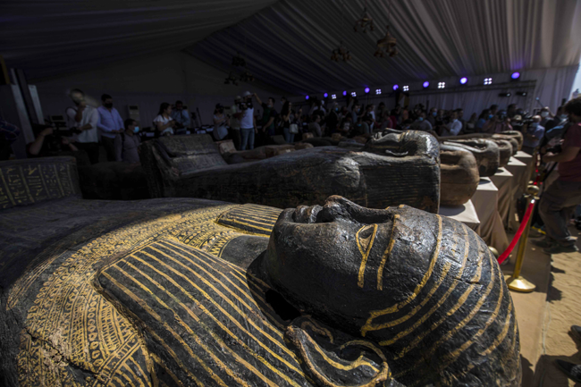 A picture taken on October 3, 2020 shows sarcophaguses, excavated by the Egyptian archaeological mission which discovered a deep burial well with more than 59 human coffins closed for more than 2,500 years, displayed during a press conference at the Saqqara necropolis, 30 kms south of the Egyptian capital Cairo.  Khaled DESOUKI / AFP