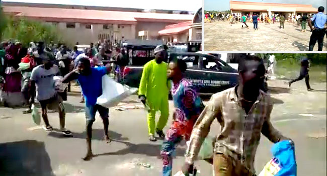 Security Officials Watch Helplessly As Crowd Loots COVID-19 Palliatives In Ilorin