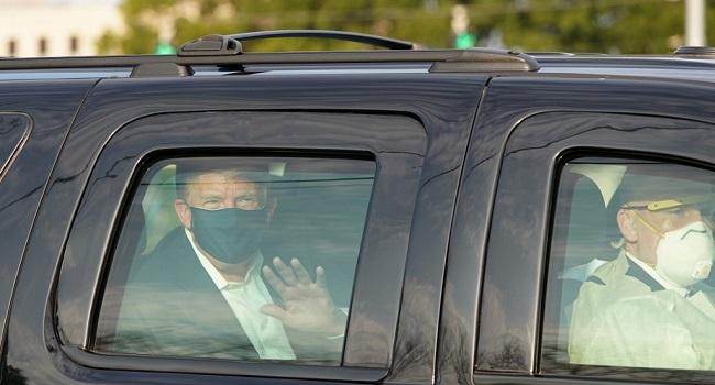 Trump in a black SUV