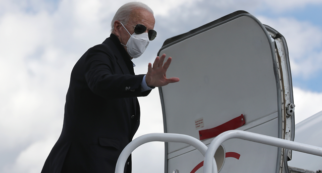 Democratic presidential nominee Joe Biden waves before traveling to Grand Rapids, Michigan, at New Castle County Airport October 2, 2020 in New Castle, Delaware.  Chip Somodevilla/Getty Images/AFP