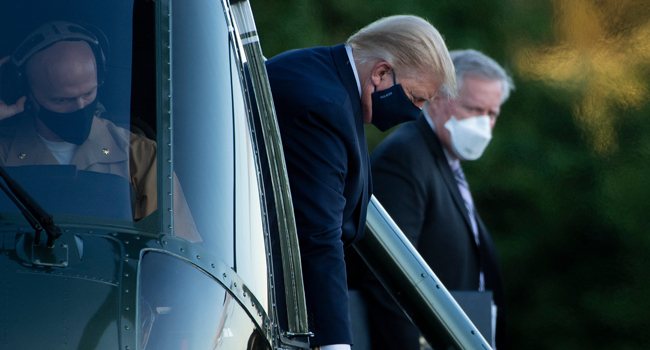White House Chief of Staff Mark Meadows (R) watches as US President Donald Trump walks off Marine One while arriving at Walter Reed Medical Center in Bethesda, Maryland on October 2, 2020. Brendan Smialowski / AFP