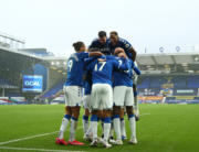 Everton's Colombian midfielder James Rodriguez celebrates with teammates after scoring their third goal during the English Premier League football match between Everton and Brighton Hove and Albion at Goodison Park in Liverpool, north west England on October 3, 2020. Jan Kruger / POOL / AFP