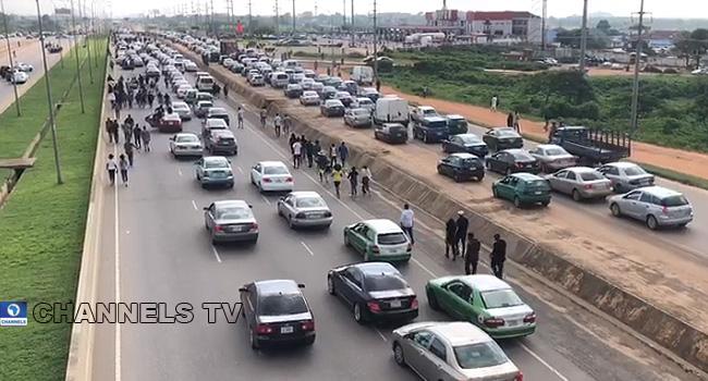 PHOTOS: #EndSARS Protesters Block Abuja Airport Road