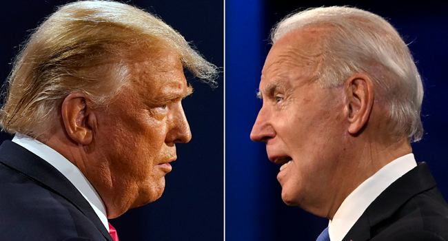 This combination of file pictures created on October 22, 2020 shows US President Donald Trump (L) and former Democratic Presidential candidate and former US Vice President Joe Biden during the final presidential debate at Belmont University in Nashville, Tennessee, on October 22, 2020. JIM WATSON, Morry GASH / AFP