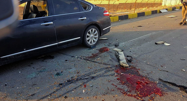 A handout photo made available by Iran state TV (IRIB) on November 27, 2020, shows the damaged car of Iranian nuclear scientist Mohsen Fakhrizadeh after it was attacked near the capital Tehran. IRIB NEWS AGENCY / AFP