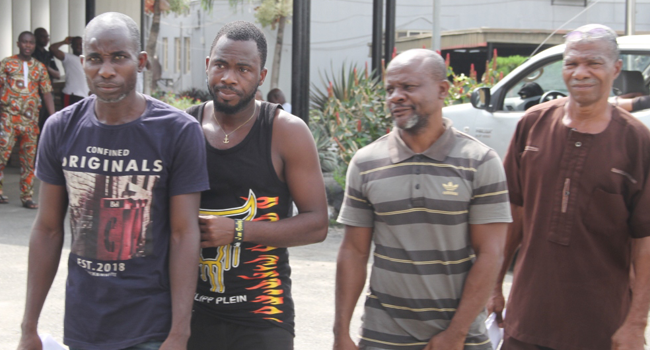 This image shows four persons who were convicted by a federal high in Lagos for oil theft on November 27, 2020.