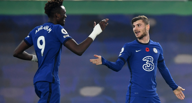 Chelsea's German striker Timo Werner (R) celebrates scoring his team's fourth goal with Chelsea's English striker Tammy Abraham (L) during the English Premier League football match between Chelsea and Sheffield United at Stamford Bridge in London on November 7, 2020. Chelsea won the game 4-1. Mike Hewitt / POOL / AFP