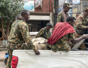 Members of the Amhara militia, that combat alongside federal and regional forces against northern region of Tigray, ride on the back of a pick up truck in the city of Gondar, on 08 November 2020. EDUARDO SOTERAS / AFP