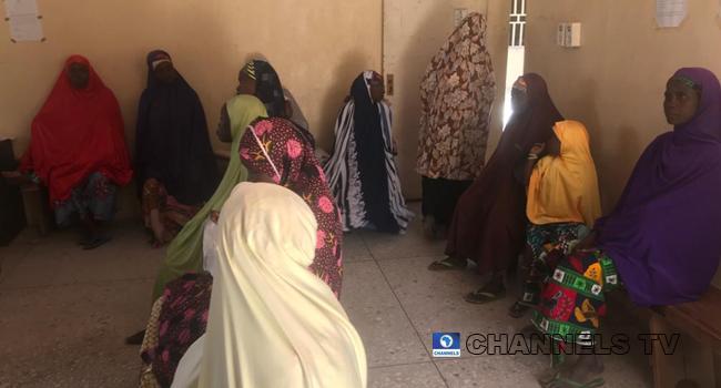 Women in a Jigawa community wait at a health centre.