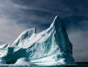 This file photo taken on June 29, 2019 shows an iceberg floating in Bonavista Bay in Newfoundland, Canada. The extent of sea ice in the Arctic was at record lows for October, Danish researchers said Wednesday, October 28, 2020, adding the unusually warm season meant it was not recovering as fast as normal. Johannes EISELE / AFP