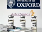 An illustration picture shows vials with Covid-19 Vaccine stickers attached and syringes, with the logo of the University of Oxford and its partner British pharmaceutical company AstraZeneca, on November 17, 2020. JUSTIN TALLIS / AFP