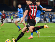 AC Milan's Swedish forward Zlatan Ibrahimovic centres the ball before feeling pain at his left leg, a thigh muscle strain during the Italian serie A football match Napoli vs AC Milan on November 22, 2020 at the San Paolo stadium in Naples. ANDREAS SOLARO / AFP