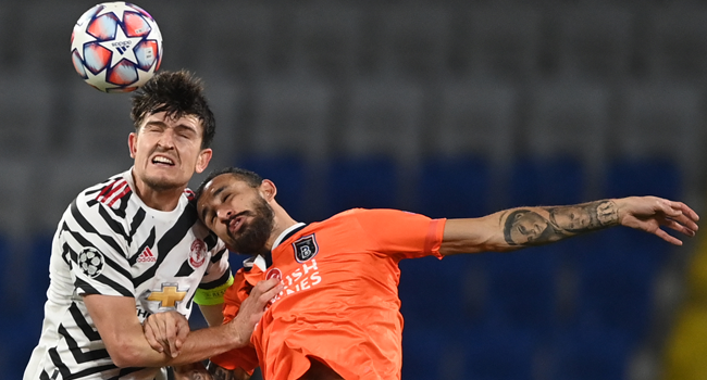 Manchester United's English defender Harry Maguire (L) fights for the ball with Istanbul Basaksehir's Turkish midfielder Mehmet Topal during the UEFA Champions League football match group H, between Istanbul Basaksehir FK and Manchester United, on November 4, 2020, at the Basaksehir Fatih Terim stadium in Istanbul. OZAN KOSE / AFP