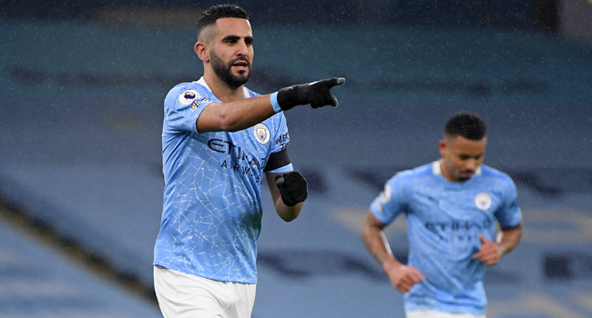 Manchester City's Algerian midfielder Riyad Mahrez celebrates after scoring his third goal, their fifth during the English Premier League football match between Manchester City and Burnley at the Etihad Stadium in Manchester, north west England, on November 28, 2020. Michael Regan / POOL / AFP