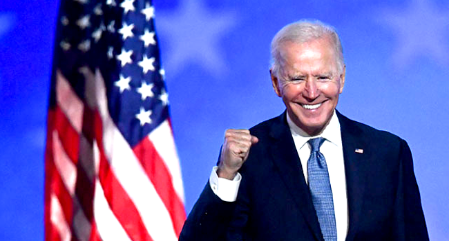 Democratic presidential nominee Joe Biden gestures after speaking during election night at the Chase Center in Wilmington, Delaware, early on November 4, 2020. ANGELA WEISS / AFP