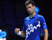 Serbia's Novak Djokovic reacts as he beats Germany's Alexander Zverev in straight sets in their men's singles round-robin match on day six of the ATP World Tour Finals tennis tournament at the O2 Arena in London on November 20, 2020. Glyn KIRK / AFP