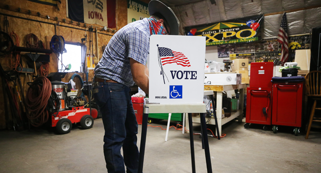 A voter marks his ballot at a polling place in Dennis Wilkening's shed on November 3, 2020 in Richland, Iowa. Mario Tama/Getty Images/AFP