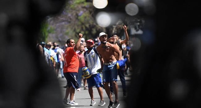 Police, Fans Clash At Diego Maradona's Wake