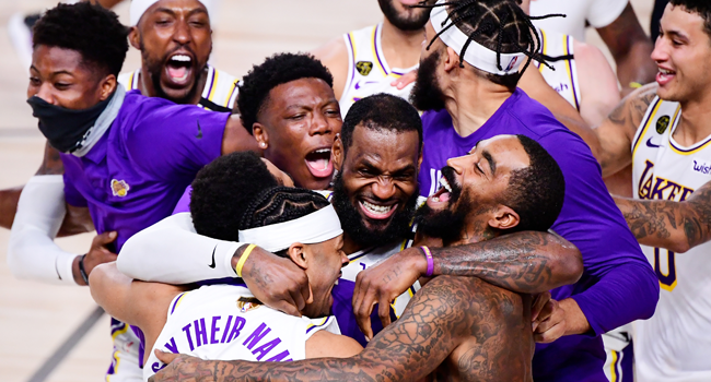 In this file photo taken on October 11, 2020, LeBron James (C) of the Los Angeles Lakers celebrates with teammates after winning the 2020 NBA Championship in Game Six at AdventHealth Arena in Lake Buena Vista, Florida. Douglas P. DeFelice / GETTY IMAGES NORTH AMERICA / AFP